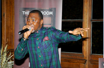 Dayo Bello singing at the 5th Anniviersary